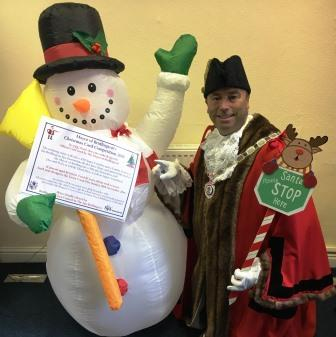 Mayor of Bridlington Councillor Liam Dealtry and a snowman launching 2016 Christmas Card Competition